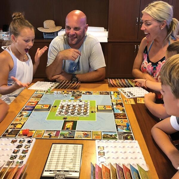 Bryan Baeulmer and family playing Build-iT With Bryan Step By Step. (CNW Group/Build-iT Games)