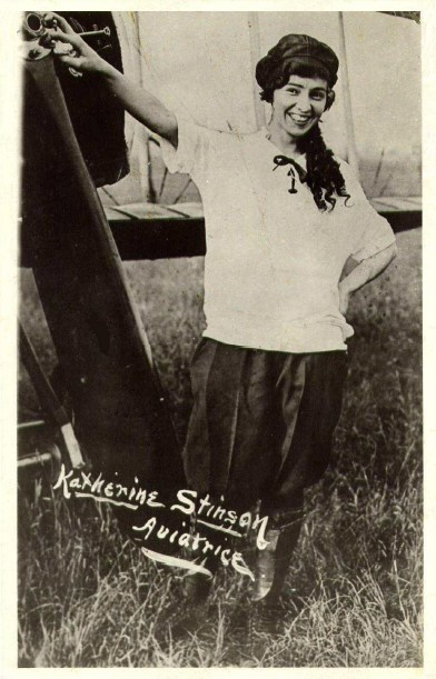 Aviatrice Katherine Stinson poses by her aircraft in 1918 (CNW Group/WESTJET, an Alberta Partnership)