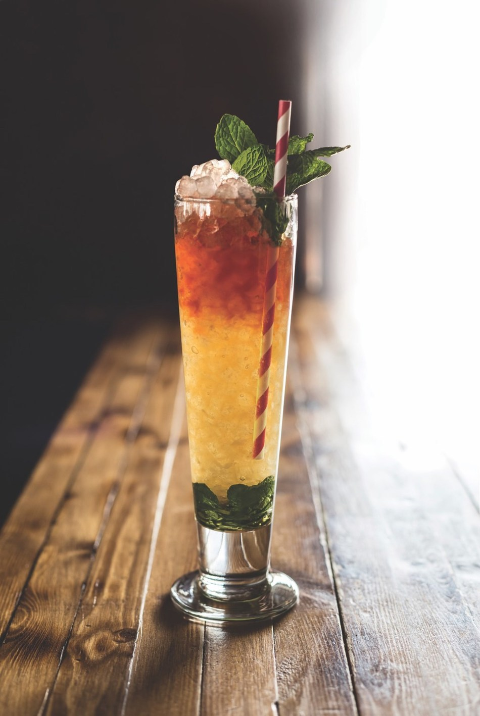 ANGOSTURA® aromatic bitters and ANGOSTURA® orange bitters are a staple in swizzled drinks, but perhaps the most iconic is the Queen's Park Swizzle. Created in Trinidad, constructed with rum and a heavy serving of ANGOSTURA aromatic bitters, it is impossible to turn down a Queen's Park Swizzle.