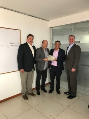 GP Strategies presents Ecopetrol with a gift recognizing its 10-year relationship. From left to right: Doug Robey, GP Strategies; Jorge Trespalacios, GP Strategies; Ezequiel Acosta, Ecopetrol; Eric Rodgers, GP Strategies.