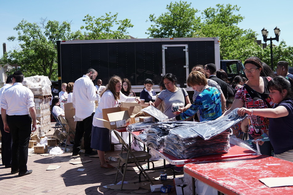 Kars4Kids volunteers distributing some of the 1000s of items given to members of the Lakewood community and greater Ocean County on June 12. Items distributed included supplies for teachers, seat cushions for seniors, toys, small kitchen appliances and children's clothing.