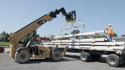 Ten trucks deliver steel I beams for the construction of the facility expansion