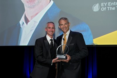 Jon Ziglar (left), CEO of ParkMobile, accepts the EY Entrepreneur of the Year Award.