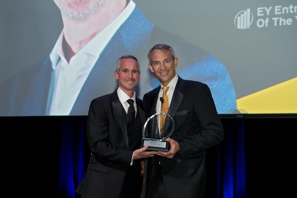 Jon Ziglar (left), CEO of ParkMobile, accepts the EY Entrepreneur of the Year Award.