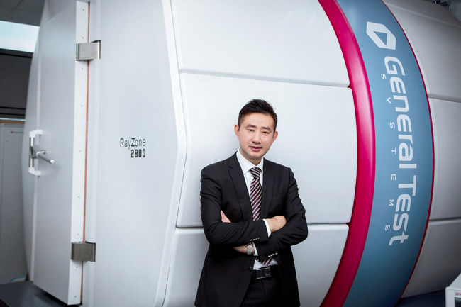 James Li, General Manager for Smart Antenna's operations in China, at the Suzhou testing facility (cold chamber in the background)