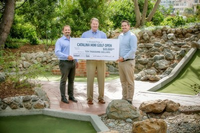 Collier Cook, Vice President of Activities Sales, Randy Herrel, President and CEO and Andrew Welham, Vice President of Activities, holding the grand prize check.