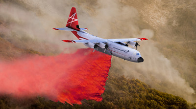"Lockheed Martin's LM-100J ""FireHerc,"" a civil-certified firefighting airtanker, builds on the C-130's proven and vital role in firefighting by dispersing retardant to contain and control fires in locations with complex terrain and compromised operating conditions. Lockheed Martin image by Marco Riccio."