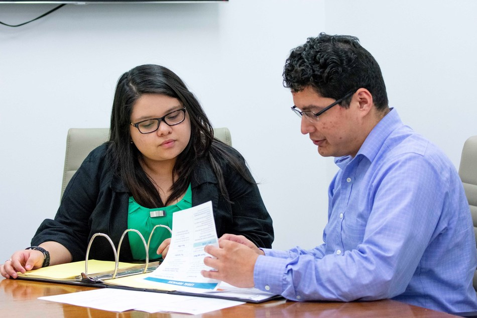 Ryan Marquez '09, a professor of practice and staff attorney with the Law Center's clinical program, and Karen Banda are leading the effort to set up a consumer assistance program at the school to help victims of Hurricane Harvey.