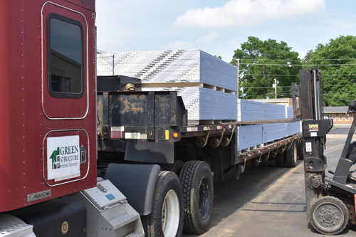 A Habitat for Humanity of Madison County Forklift Prepares to Unload a Truckload of GSH of Alabama, LLC Drywall.