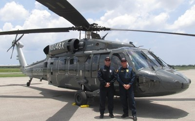 San Diego Fire-Rescue Senior Pilot Chris Hartnell (left) and Chief Chuck Macfarland accepted the department's first S-70 Black Hawk helicopter June 27 from Sikorsky, just six months after contract award. The aircraft will be painted in San Diego Fire-Rescue livery before being put into aerial firefighting action later this year.