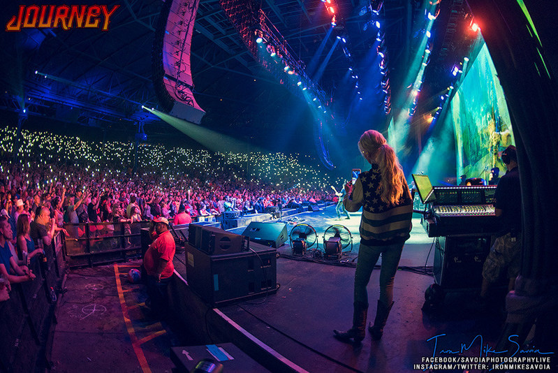 """Michaele Schon Looks on as Neal Schon Performs """"Star-Spangled Banner"""" Before Active Duty Soldiers in Milwaukee, WI 7/4/2018. (PRNewsfoto/Neal Schon)"""