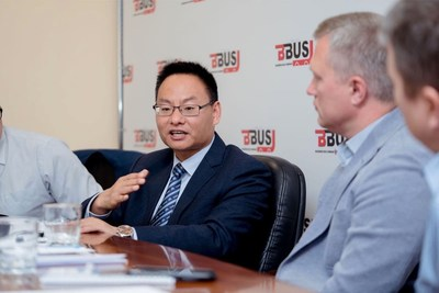 Hu Huai Ban, General Manager of Overseas Markets (left), Yutong Bus and Alexander Strukov, Founder of BBus (right)