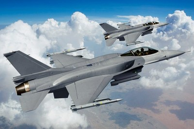 Raytheon's partnership with BAE Systems provides pilots with real-time, mission critical information using its projector for BAE Systems' Digital Light Engine head-up display on the UAE's F-16.  (Photo: Lockheed Martin)