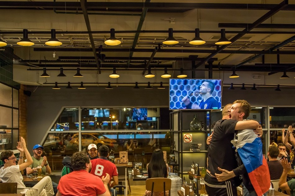 Fans watch a World Cup match at Moscow's Sheremetyevo Airport.