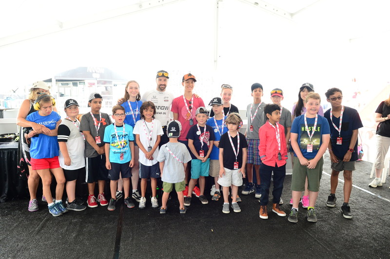 Canadian IndyCar driver James Hinchcliffe visits with Make-A-Wish® Canada children on Fan Friday at the 2018 Honda Indy Toronto.  The weekend event raised close to $90,000 to help grant the wishes of children living with critical illnesses. (CNW Group/Honda Canada Inc.)