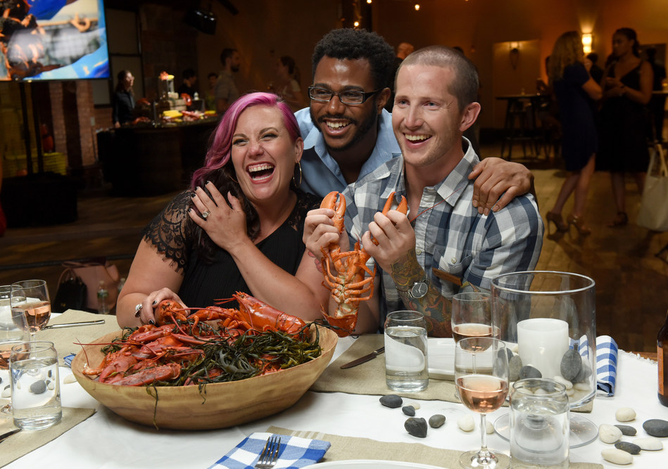 Chefs Karen Akunowicz, left, and Kwame Onwuachi, center, share their love of the versatility of Maine New Shell Lobster with Lobsterman Cyrus Sleeper at a culinary industry event hosted by the Maine Lobster Marketing Collaborative on Monday, July 16, 2018 in Brooklyn, New York. For information and recipes with Maine New Shell Lobster, visit www.lobsterfrommaine.com. (Diane Bondareff/AP Images for The Maine Lobster Marketing Collaborative)
