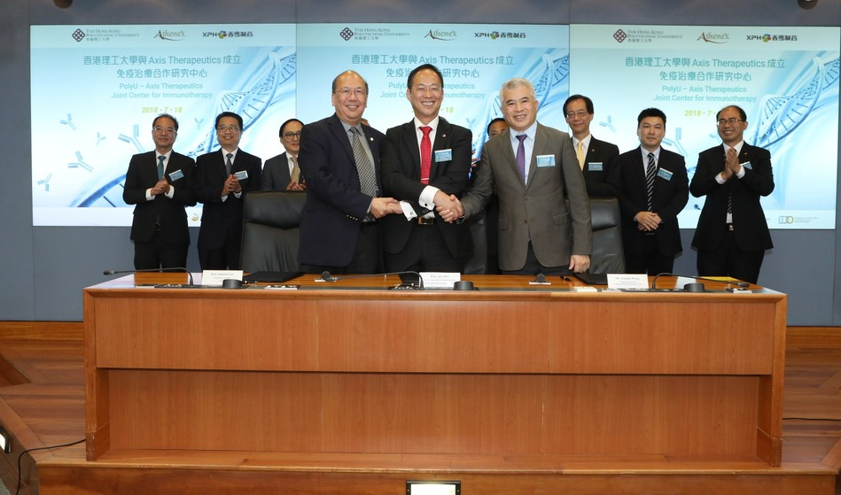 Ir Professor Ping-kong Alexander WAI, Vice President (Research Development) of PolyU (front row, center); Dr Johnson LAU, Chairman and CEO of Athenex, Inc. (front row, left); and Mr YongHui WANG, Chairman and CEO of Xiangxue Pharmaceutical and CEO of Xiangxue Life Sciences (front row, right) sign the MoU for setting up the PolyU—Axis Therapeutics Joint Center for Immunotherapy (PRNewsfoto/PolyU)