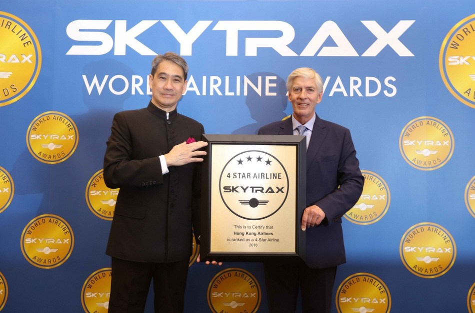 Hong Kong Airlines Vice Chairman Mr Tang King Shing (left) accepts the Skytrax 4-star award from Skytrax Chief Executive Edward Plaisted (right)