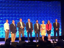 The Alitek team receiving Top Implementation of the Year Award at Open Text Enterprise World 2018