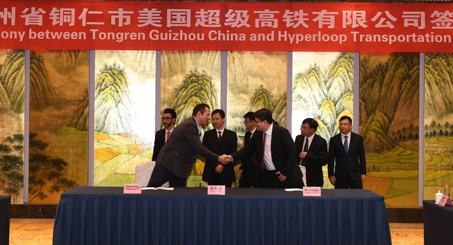 Dirk Ahlborn, CEO Hyperloop Transportation Technologies, and Tao Lang, Chairman, Tongren Tourism & Transportation Investment Group Sign Historic Agreement