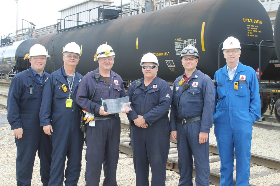 CITGO Lemont Tank Car Loaders were presented with the BNSF Product Stewardship Award by Jeff Hawthorne, CITGO Operations Unit Supervisor, and Glenn Rabinak, CITGO Engineering and Business Services General Manager.