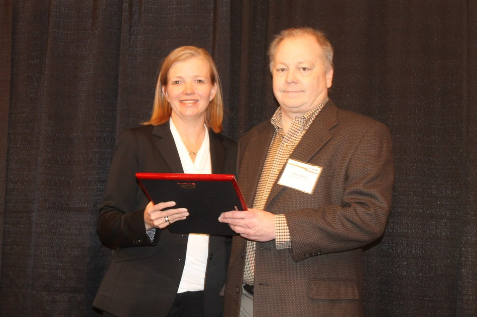 CITGO Health and Safety Manager Casey Bullock accepts the TRMA Partnership Award on behalf of the CITGO Lemont Refinery.