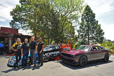 HEMI® power thundered across Colorado as Dodge unveiled the 485-horsepower 2019 Dodge Challenger R/T Scat Pack 1320 and Mopar introduced the 10,000-plus-horsepower 2019 Dodge Charger SRT Hellcat Funny Car for NHRA competition on Thursday, July 19. Shown from left are: Mopar Dodge NHRA driver Leah Pritchett; Steve Beahm, Head of Passenger Car Brands – Dodge//SRT, Chrysler and FIAT, FCA – North America; John Fox, Head of Mopar Sales and Product Development; and Mopar Dodge NHRA driver Matt Hagan.