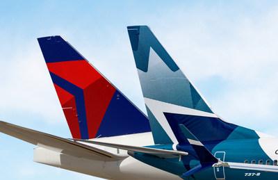WestJet et Delta ont signé une entente définitive pour former une coentreprise transfrontalière globale. (Groupe CNW/WESTJET, an Alberta Partnership)