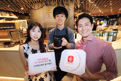 Models pose with a Starbucks barista at the global coffee chain's premium Reserve store at the Jongno Tower in downtown Seoul on July 17.
