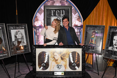 Taylor Swift is presented with six RIAA certified plaques by Big Machine Label Group President and CEO Scott Borchetta backstage during a record-breaking reputation Stadium Tour stop in New Jersey