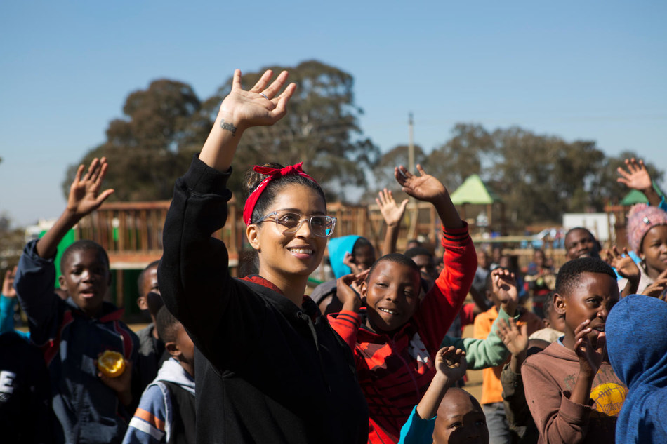 On 22 July 2018 in South Africa, UNICEF Goodwill Ambassador Lilly Singh interacts with children during a visit to the Isibindi Safe Park in Soweto. © UNICEF/UN0223959/Prinsloo (CNW Group/UNICEF Canada)