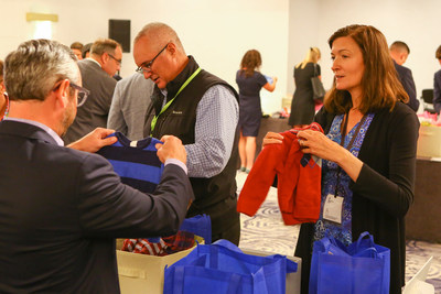 Michelle Borré, Portfolio Manager, Oppenheimer Fundamental Alternatives Fund and Oppenheimer Capital Income Fund, assembles care packages at the firm's Distribution Symposium in Chicago. (PRNewsfoto/OppenheimerFunds)