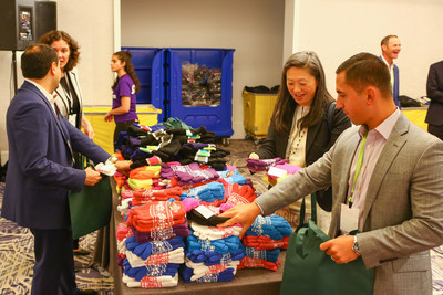 OppenheimerFunds General Counsel Cynthia Lo Bessette and colleagues volunteer with Cradles to Crayons and the Boys & Girls Clubs of Chicago during the firm's Distribution Symposium in Chicago. (PRNewsfoto/OppenheimerFunds)
