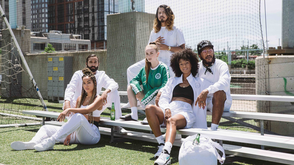 """HEINEKEN PARTNERS WITH KAPPA USA® FOR LIMITED-EDITION """"#HEINEKEN100"""" SIX-PIECE CAPSULE COLLECTION. The Coveted 2018 #Heineken100 Collection Partners Two Global Iconic Brands with a Rich Heritage of Supporting Soccer Style and Culture."""