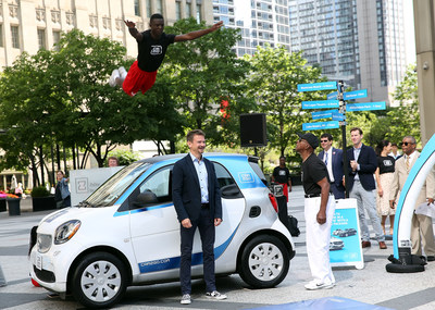 Global CEO of car2go Group GmbH and the Jesse White Tumblers kicking off car2go launch in Chicago on July 25 - Photo Credit: Getty Images