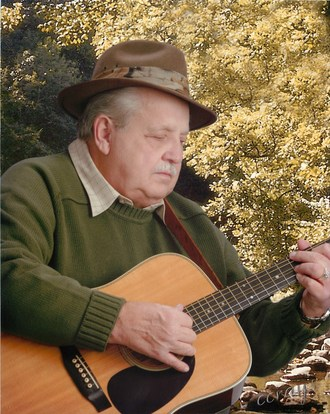 Bluegrass Songwriter and Singer Pete Goble with Guitar (PRNewsfoto/The Goble Family)