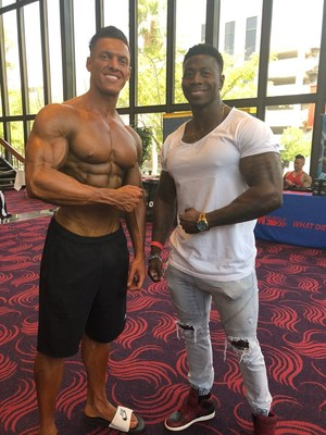 Carlos DeOliveira with last year's IFBB pro winner, Kyron Holden.
