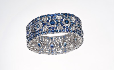 The Alexandra, a custom designed art deco-inspired piece, handcrafted in 18K white gold and featuring 68.25 ctw of very fine vibrant blue sapphires and 6.44 ctw of diamonds.
