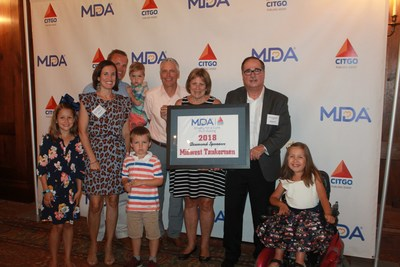 The Plasman family with MDA and Jim Cristman, CITGO Vice President  of Refining, thank Diamond Sponsor Midwest Tankermen for their dedication to the golf outing and the MDA.