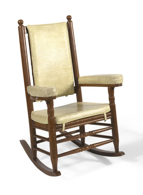 One of two rocking chairs being auctioned Friday, it was upholstered for President Kennedy to help relieve his chronic back pain.