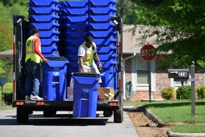 """Here, new curbside recycling carts are being delivered to homes in Florence, Alabama. The new """"All In On Recycling"""" challenge is expected to fund carts for more than 550,000 additional single-family households in communities across the country."""