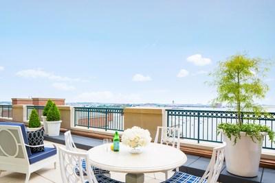 Private terrace overlooking Boston Harbor at Boston Harbor Hotel's John Adams Presidential Suite