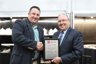 Ashley Turner, Hussmann Vice President of Branch Operations, and Mike Couling, Lincoln Tech - Grand Prairie Campus President, commemorate the opening of the Hussmann TechX Advanced Training Center for Refrigeration on Lincoln Tech's Grand Prairie campus.