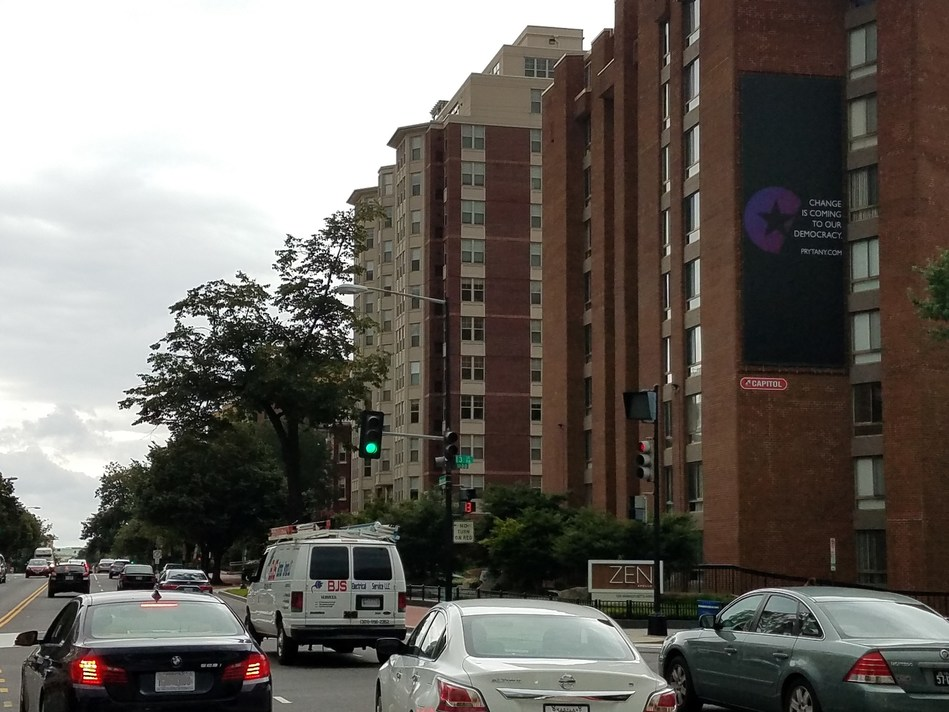 Prytany sign at 13th and Massachusetts Avenue, NW in Washington, DC, with traffic moving east.