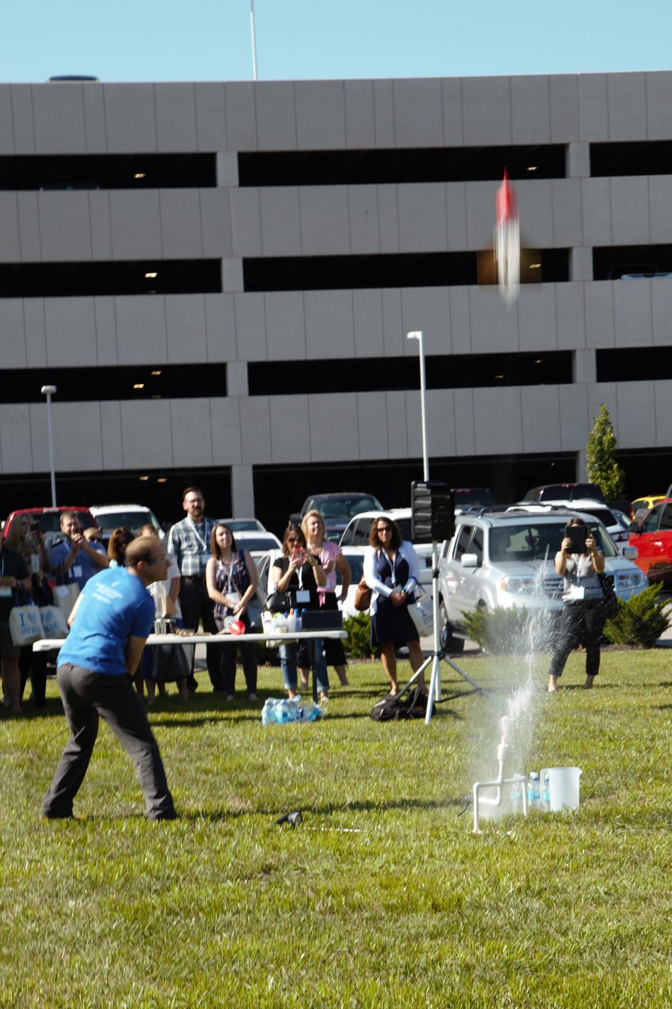 Burns & McDonnell employee-owners demonstrated engaging STEM activities to educators they could recreate for their students at school, such as launching a water bottle rocket to learn about Newton's Law of Motion.