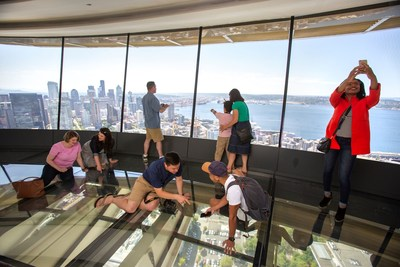Space Needle guests enjoy The Loupe - the world's first and only glass floor.