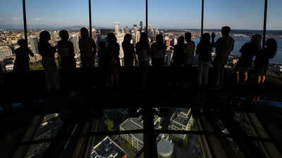 Space Needle guests stand on The Loupe - the world's first revolving glass floor. Courtesy of Rod Mar.