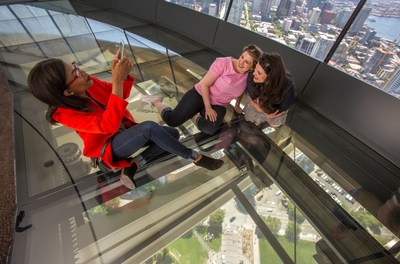 Space Needle guests take a photo on The Loupe - the world's first revolving glass floor. Courtesy of John Lok.