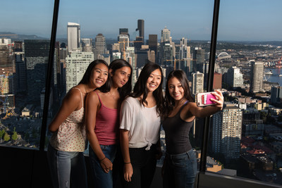 Space Needle guests take selfies on The Loupe - the world's first revolving glass floor.