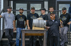 Guinness Brewmaster Peter Wiens and his team tap a ceremonial firkin in celebration of the Open Gate Brewery & Barrel House ribbon-cutting ceremony on August 2, 2018 in Halethorpe, Maryland.